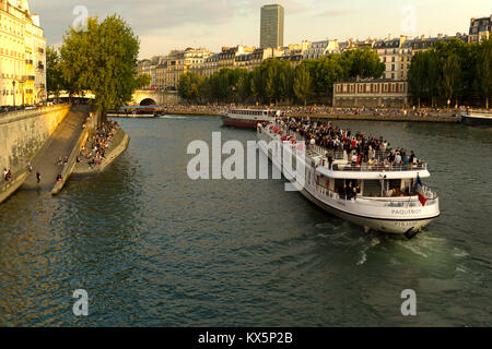 Group on a boat tour on the Seine river - Stock Photo