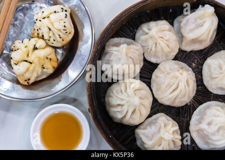Traditional Shanghai food including dumpling, wonton and xiaolongbao - Stock Photo