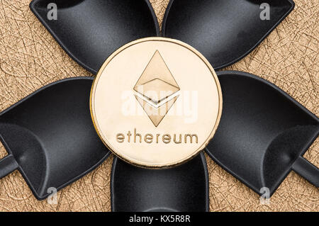 Top view silver ethereum crypto coin over black shovel mining on golden rough ground texture,Cryptocurrency digital - Stock Photo