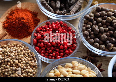 Red pepper and other spices on a wooden surface - Stock Photo