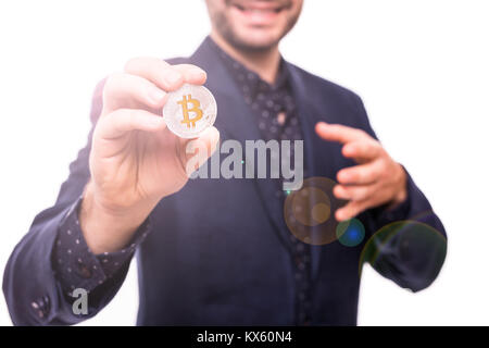 Closu up of handsome business man in suit with silver bitcoin in hand isolated on white - Stock Photo