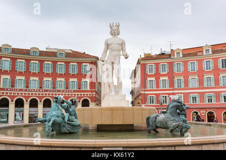 Fontaine du Soleil, Sun fountain with Apollo statue in Place Massena, Nice, France - Stock Photo