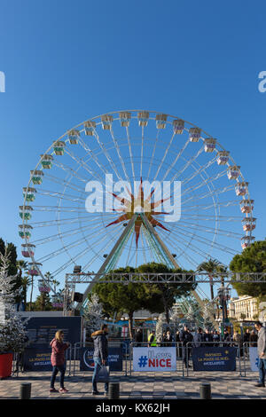 Giant ferris wheel and Christmas Market, Place Massena winter sun with blue sky in Nice, French Riviera, Cote d'Azur, - Stock Photo