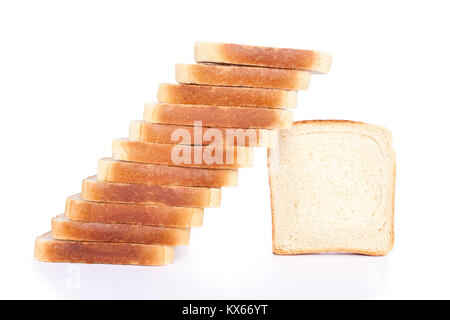 Toast slices arranged in the shape of steps, isolated on white background - Stock Photo