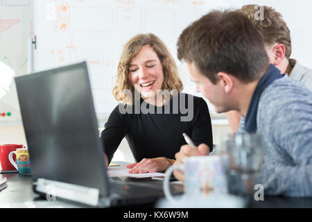 Relaxed informal IT business startup company team meeting. - Stock Photo