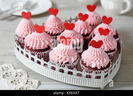 Cupcakes.  Red velvet cupcakes decorated with red hearts - Stock Photo