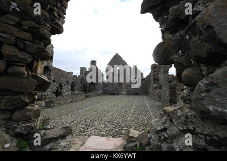 Inner walls and interior of Dunluce Castle, a medieval castle on the Causeway coast, a popular tourist attraction - Stock Photo