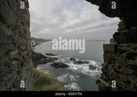 View from castle in Northern Ireland - looking along the Causeway coast from the ruins of Dunluce Castle, County - Stock Photo