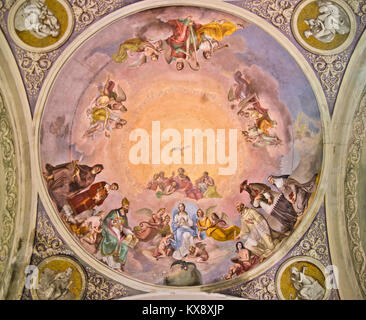 church fresco depicting the Madonna, God and Holy Spirit in the blue sky - Stock Photo
