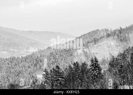 Landscape view on a Beskid mountains in Szczyrk covered in white snow - Stock Photo