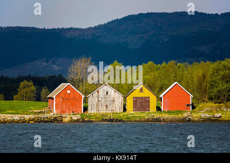 Boathouses on a traditional coastal farm in the Gjemnes area, on the northwest coast of Norway, close to Kristiansund. - Stock Photo