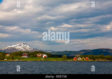 A typical coastal farm in the Gjemnes area, on the northwest coast of Norway, close to Kristiansund. Combined farming - Stock Photo