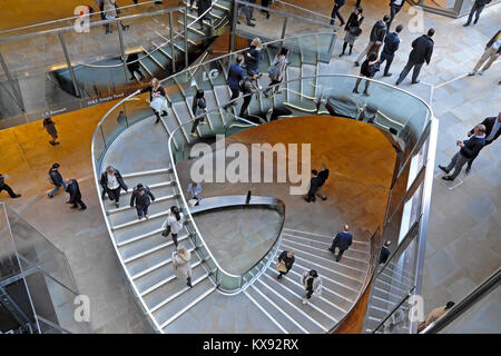 Overhead view looking down on people walking on stairway inside the shopping centre at One New Change in Central - Stock Photo