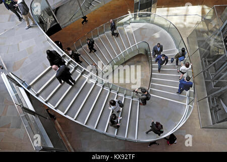 Overhead view looking down on people walking on stairway staircase inside the shopping centre at One New Change - Stock Photo