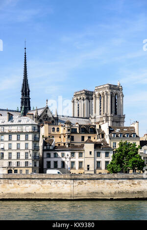 View of Notre-Dame de Paris cathedral on the Ile de la Cite with medieval and Haussmannian buildings in the foreground. - Stock Photo