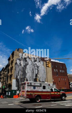 At the intersection of Franklin and Church Streets in Tribeca, JR, a French street artist, created a giant, photographic - Stock Photo