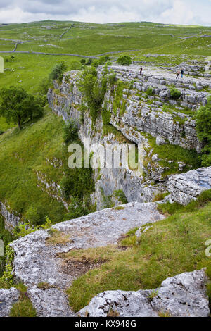 Malham Cove and the limestone pavement above, from the eastern lip of the cove, North Yorkshire - Stock Photo