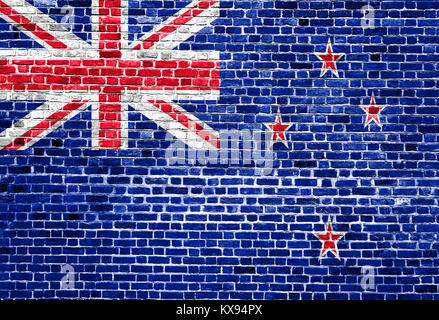 Flag of New Zealand painted on brick wall, background texture - Stock Photo