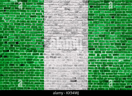 Flag of Nigeria painted on brick wall, background texture - Stock Photo