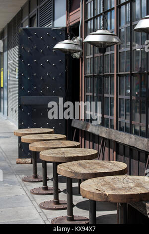London, UK - August 17, 2017: Tables outside at the urban cafe with modern lamps in the Art Nouveau style - Stock Photo