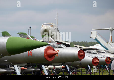A collection of Sukhoi fighters before the Tupolev Tu-144 on display in Monino museum. - Stock Photo