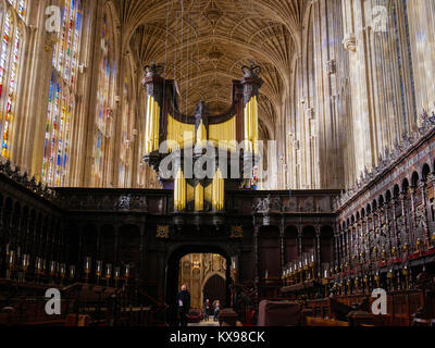 The organ above the wooden rood screen in the chapel at King's college, Cambridge university, England. - Stock Photo