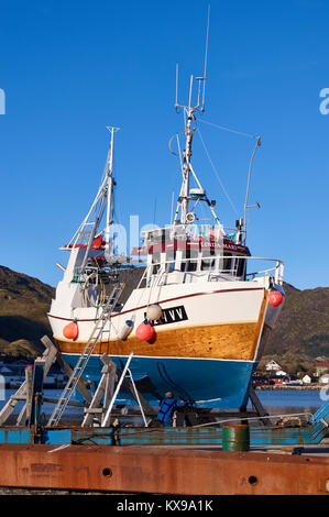 Fishing boat being repaired, Ballstad harbour, Vestagoy, Lofoten, Nordland, Norway - Stock Photo