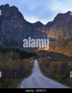 Road to Nusfjord, Flakstadoya, Lofoten islands, Nordland, Norway.  Cliff face of Stjerntinden - Stock Photo