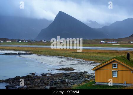View of Volandstinden on Flakstadoya from Ytresand, Moskenesoya, Lofoten, Nordland, Norway.  Overlooking Sandbotnen - Stock Photo