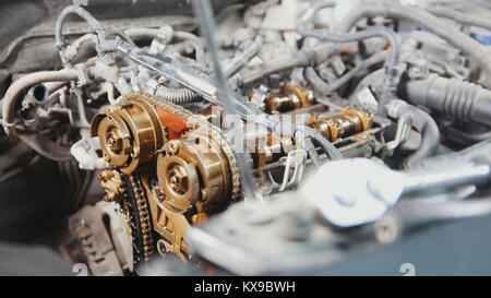 The internal combustion engine, disassembled, repair at car service, overhaul, under the hood of the car - Stock Photo