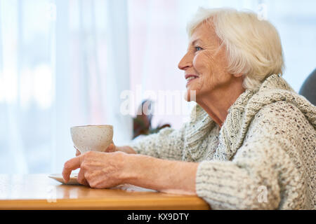 Senior Woman with Cup of Fragrant Coffee - Stock Photo
