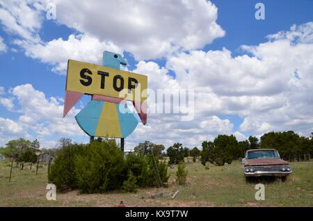 a hand painted thunderbird style sign and vintage car in pietown new mexico - Stock Photo