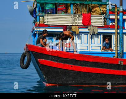 Tho Chau, Vietnam - Dec 14, 2017. People working on fishing boat in Tho Chau Island, Vietnam. Tho Chau Islands (Poulo - Stock Photo