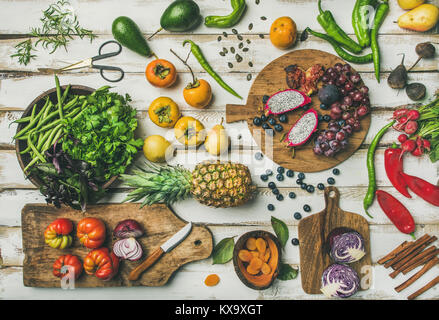 Helathy vegan food cooking background with fruits and vegetables - Stock Photo