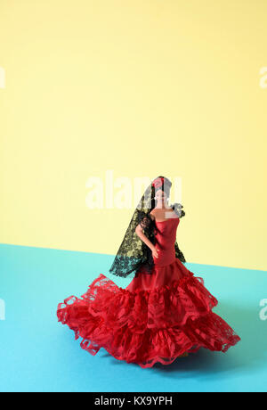 a typical spanish doll dressed as a flamenco dancer, with the characteristic traje de flamenca, the typical dot - Stock Photo