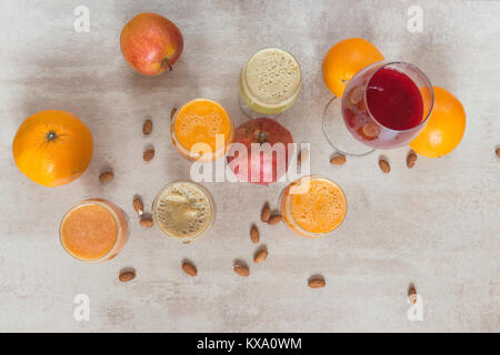 Fresh juice mix vegetables and fruit, healthy drinks on grey table - Stock Photo