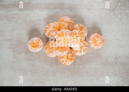 Orange Mandarines, Clementines, Tangerines or small oranges - Stock Photo