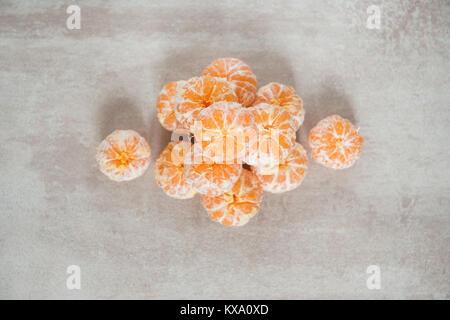 Orange Mandarines, Clementines, Tangerines or small oranges - Stock Photo