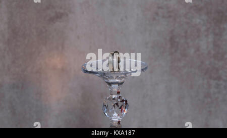 Golden wedding rings isolated on grey background. Romeo and Juliet - Stock Photo