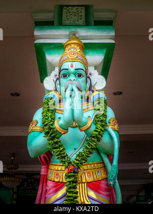 One of many statues to Hanuman, a popular Hinduism deity, that stand in the popular tourist attraction , Batu Caves - Stock Photo