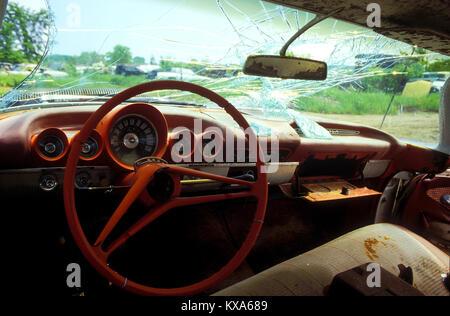 Iinterior of old vintage car in junkyard - Stock Photo