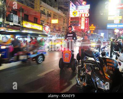 Thai police patrol Bangkok's Chinatown on Segways to curb street food - Stock Photo