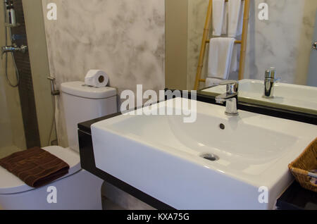 Modern white sinks in the bathroom. - Stock Photo