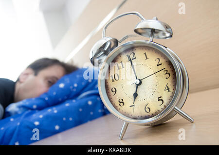 Sleeping Man Disturbed By Ringing Alarm Clock After A Sleepless ...