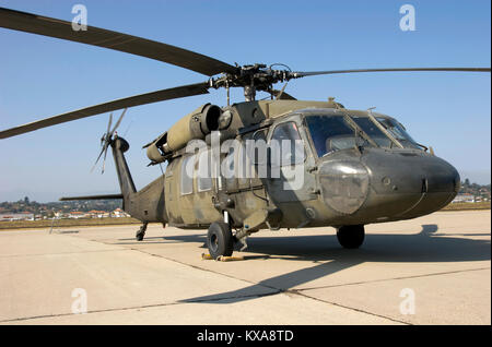Combat chopper sitting on the tarmac - Stock Photo