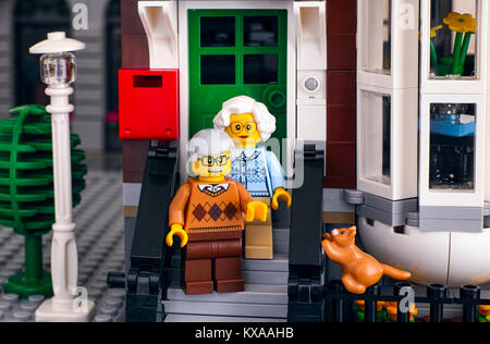 Tambov, Russian Federation - October 18, 2017 Lego senior couple standing on the porch of their house and his ginger - Stock Photo
