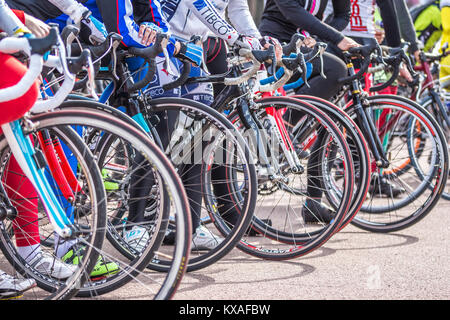 Gomel, Belarus - April 10, 2016: Close-up of bicycle wheels on the start after opening the bicycling season 2016 - Stock Photo
