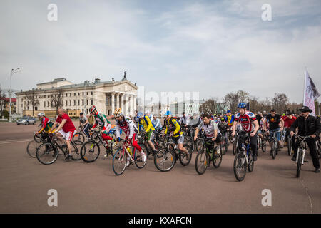 Gomel, Belarus - April 10, 2016: Bicyclists begin movement in honor of the bicycle season in 2016 on Lenin Square - Stock Photo