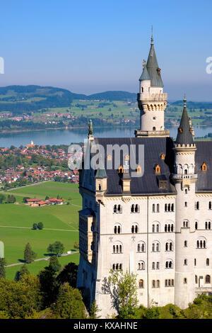 Neuschwanstein Castle, in the back Forggensee, Schwangau, Königswinkel, Ostallgäu, Allgäu, Swabia, Bavaria, Germany - Stock Photo