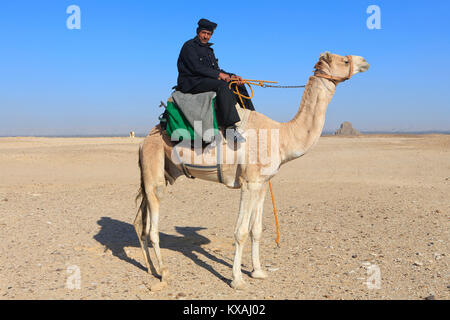 A mounted Egyptian police officer in front of the Black Pyramid of Egyptian Pharaoh Amenemhat III (12th dynasty) - Stock Photo